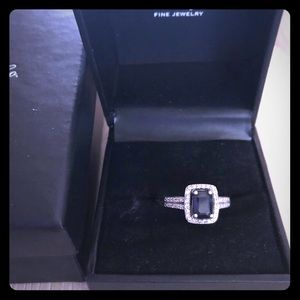 Square cut sapphire and diamond ring.